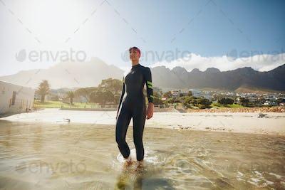 Triathlete in training at the beach