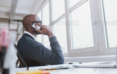 Executive on phone while at work