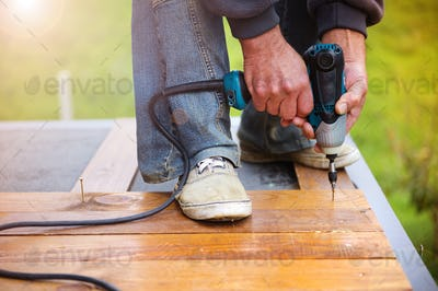Handymen installing wooden flooring
