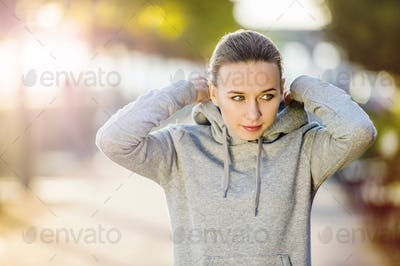 Sporty woman during morning walk