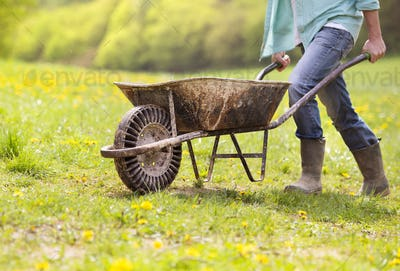 Farmer with wheelbarrow