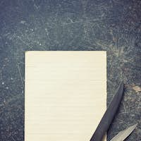 sheet of paper with knives