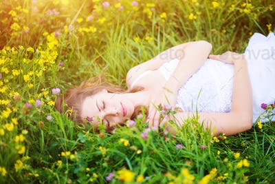 Beautiful woman on a meadow.