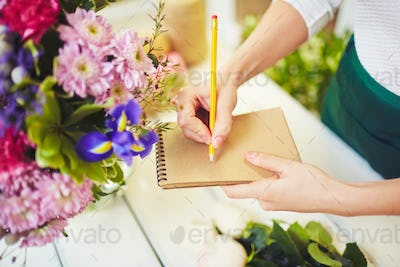 Florist with notepad and pencil