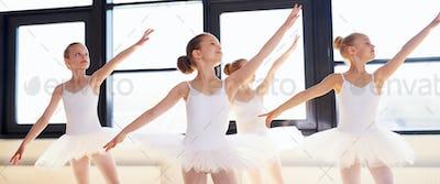 Young ballerinas practicing a choreographed dance
