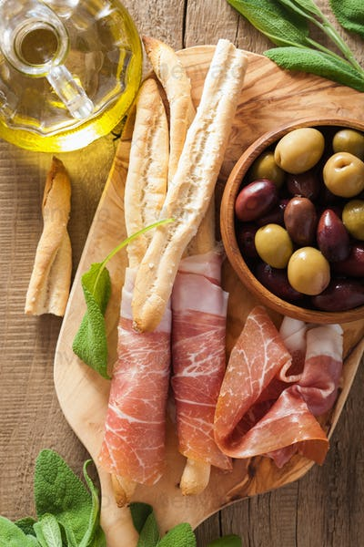 italian prosciutto ham grissini bread sticks olive oil