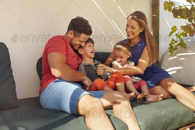 Happy young family spending time together