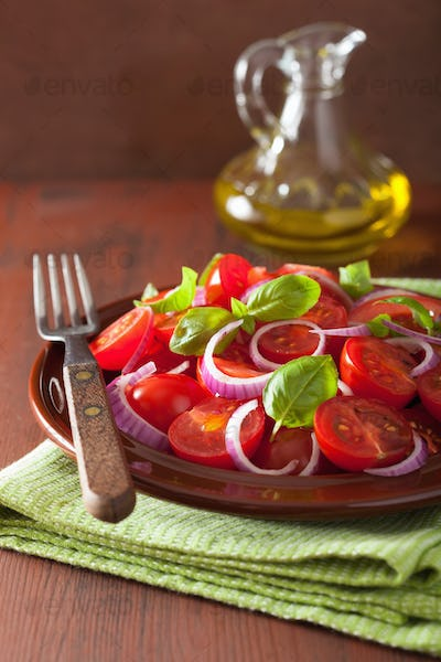 healthy tomato salad with onion basil olive oil and balsamic vin