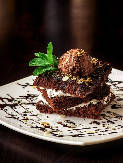 Chocolate brownie cake with a scoop of ice cream.