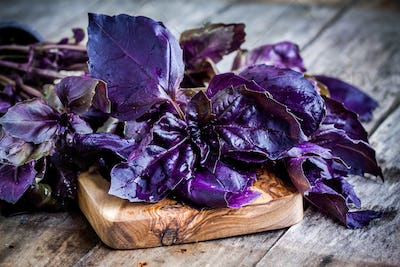 beam of purple basil on cutting board