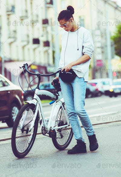 Colorful outdoor portrait of young pretty fashion model with bike. sexy woman posing in summer