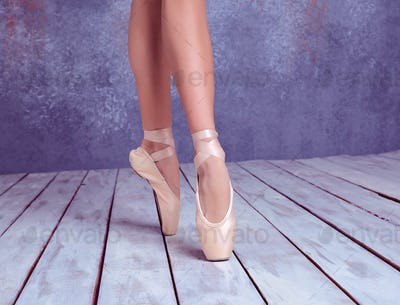 The feet of a young ballerina in pointe shoes