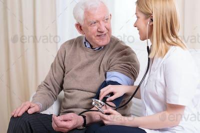 Caregiver checking the hypertension