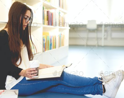 Young woman scholar relaxing with her books