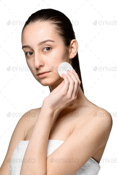 skin care woman removing face with cotton swab pad