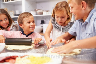 Children making pizza together