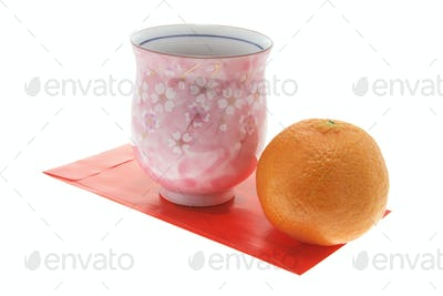 Mandarin, Teacup and Red Packet