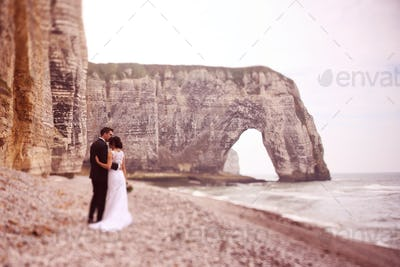 Bride and groom at Normandy shore