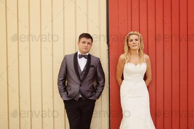 Bride and groom agaist wooden wall