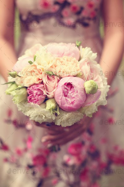 Beautiful wedding bouquet and floral dress