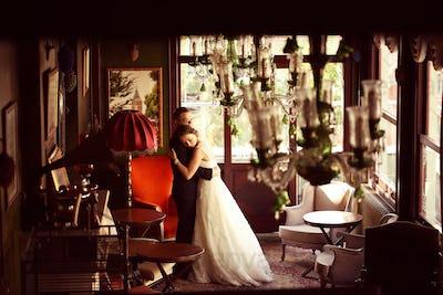 Bride and groom dancing in a beautiful room