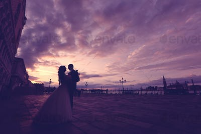 Bride and groom on sunset in Venice