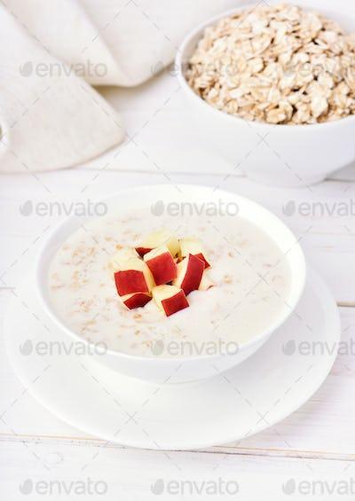 Oat porridge with red apple slices