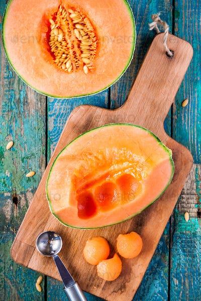 preparation melon balls on a wooden cutting board
