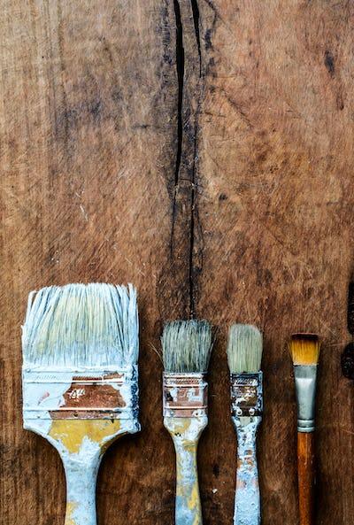 grunge paintbrush on old wood background