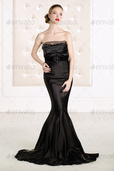 Beautiful woman wearing black elegant dress