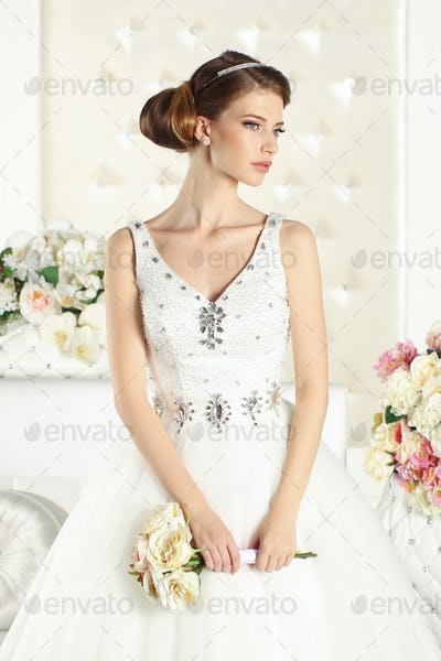 Gorgeous bride in a white room
