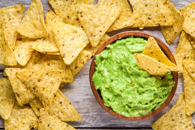 homemade guacamole with corn chips top view