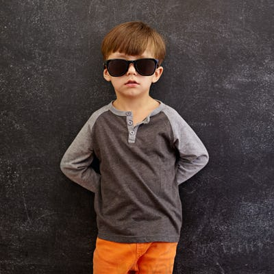 Innocent little kid wearing sunglasses