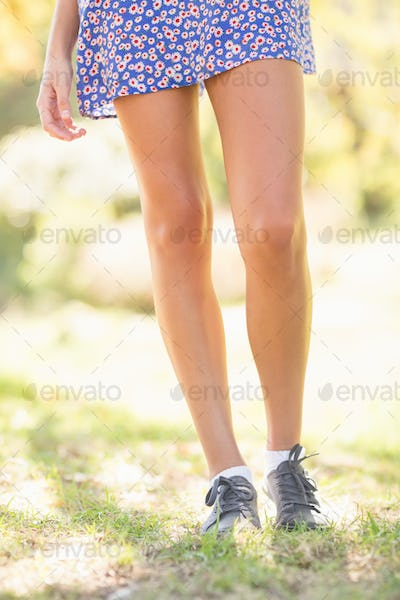 Casual girl walking in the park on a sunny day