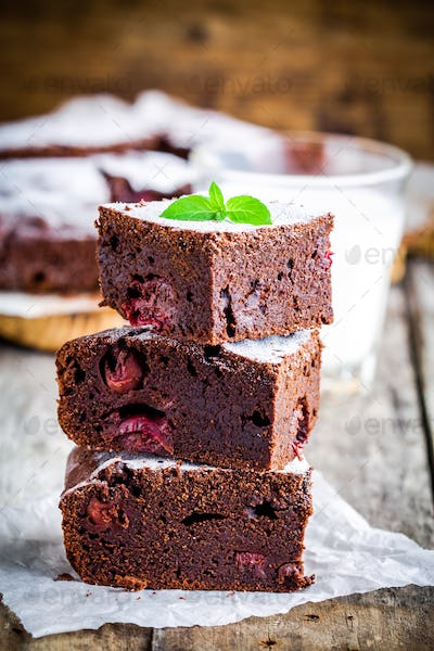 pieces of homemade chocolate brownie dessert with cherries