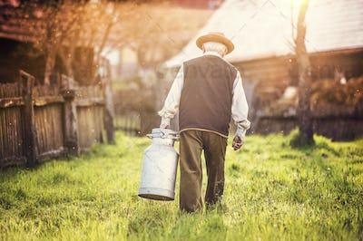 Farmer with milk kettle