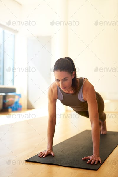 Fit woman doing press ups