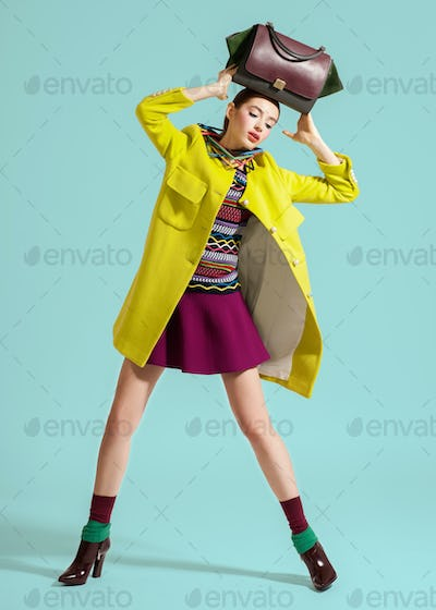 Fashion model pose on light background