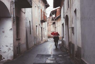 Man Walking On Street With Umbrella