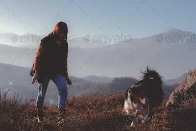 Woman With Dog On Mountains