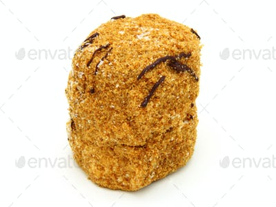 Honey cake with chocolate on a white background