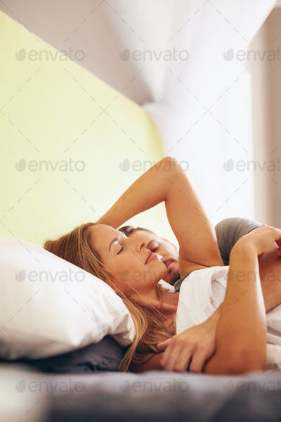 Young couple resting on bed