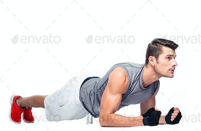 Fitness man doing exercises on the floor