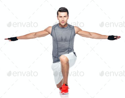 Full length portrait of a fitness man stretching