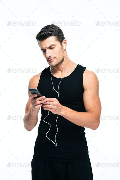 Fitness man using smartphone with headphones