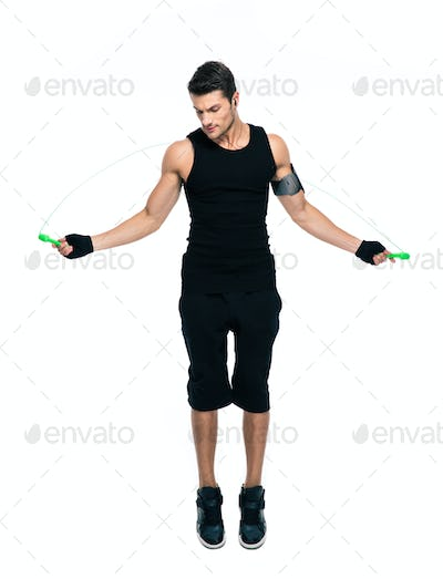 Fitness man jumping with skipping rope