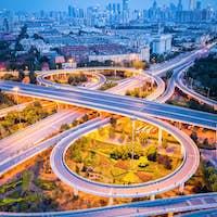 modern interchange road with city skyline