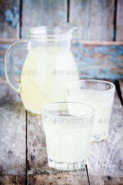 citrus cold homemade lemonade on wooden table