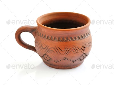 Ceramic cup on a white background