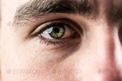 Close up of man eye looking up